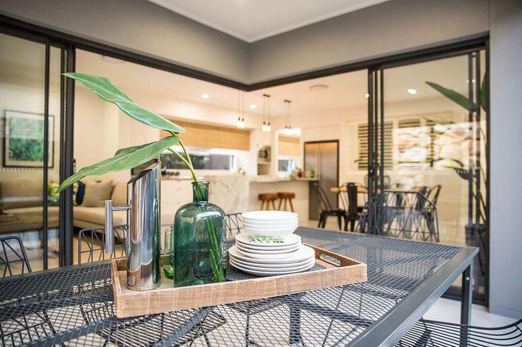 Alfresco. Black sliding doors. Kitchen, living, dining.