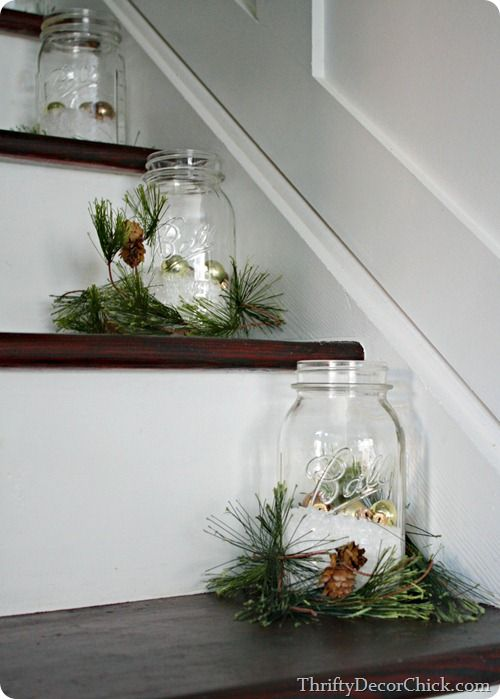 Fill mason jars with fake snow, ornaments and fresh greenery for a festive stair (via Thrifty Decor Chick).