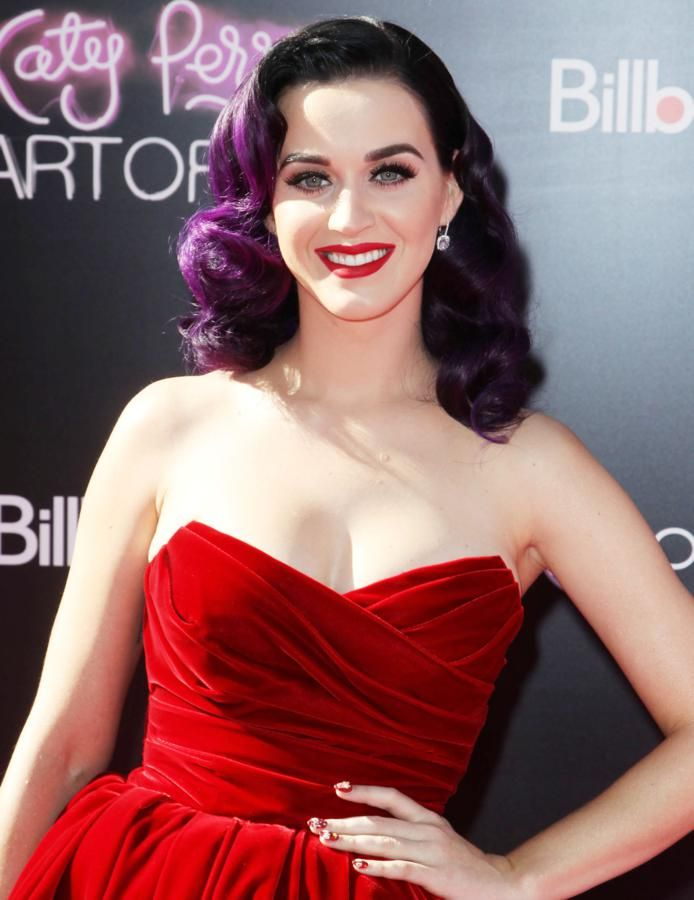 Katy Perry complements her clutch with cherry-beaded metallic red nails