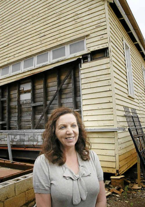 General manager of the Empire Theatre Ann-Marie Ryan outside the old shed. INSET: The inside of the old shed.