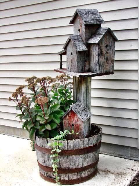 Birdhouse in whiskey barrel