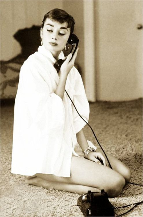 Audrey Hepburn on the phone at her home in Los Angeles, 1950s.