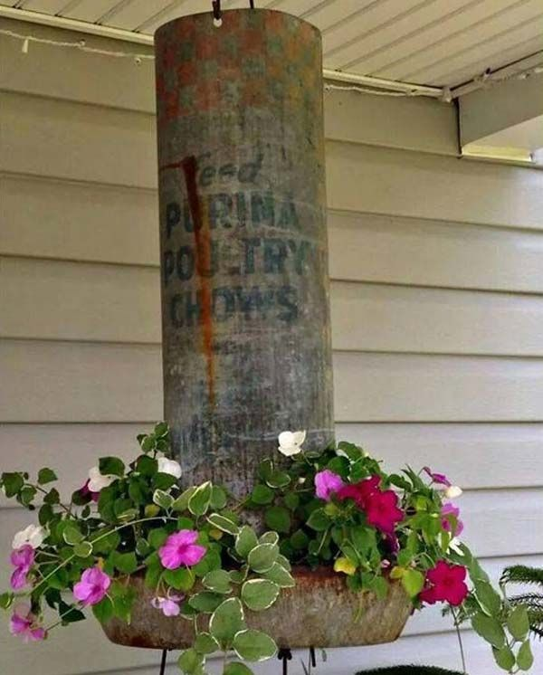 10. Old Chicken feeder repurposed into a hanging planter - Top 20 Crazy Ideas to Repurpose Chicken Feeders