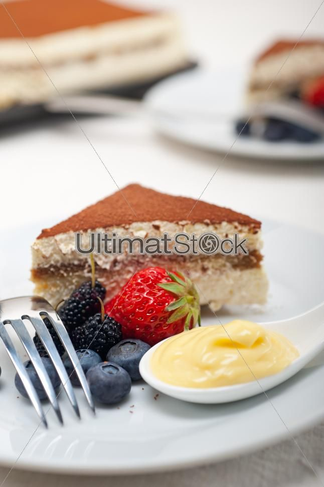 Tiramisu dessert with berries and cream