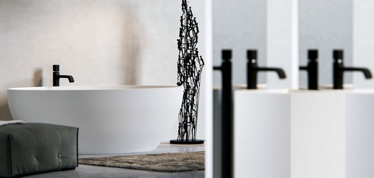 Clay CUBIC - Made to measure monolith in white Solid surface. In the background our Ellipse freestanding Solid surface bathtub.