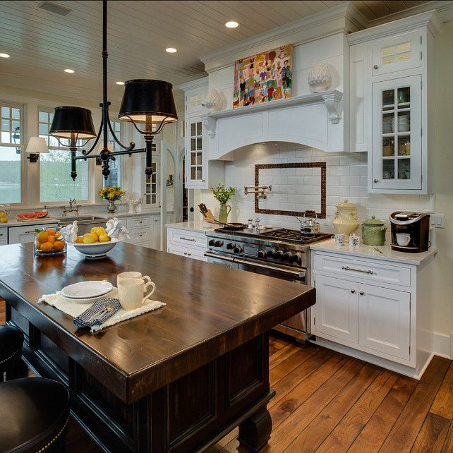 "This kitchen island was custom designed and fabricated.  Light fixture above island is the ""Sloane Street Double Billiard Light"" from Circa Lighting."