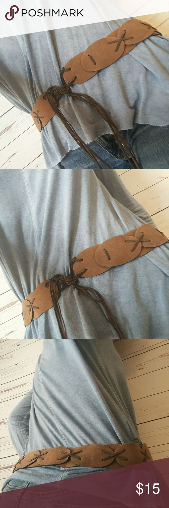 Brown tie up belt Western looking tie up belt. Very versitle on the size since the strings are long and can be tied in front. Good condition. Accessories Belts