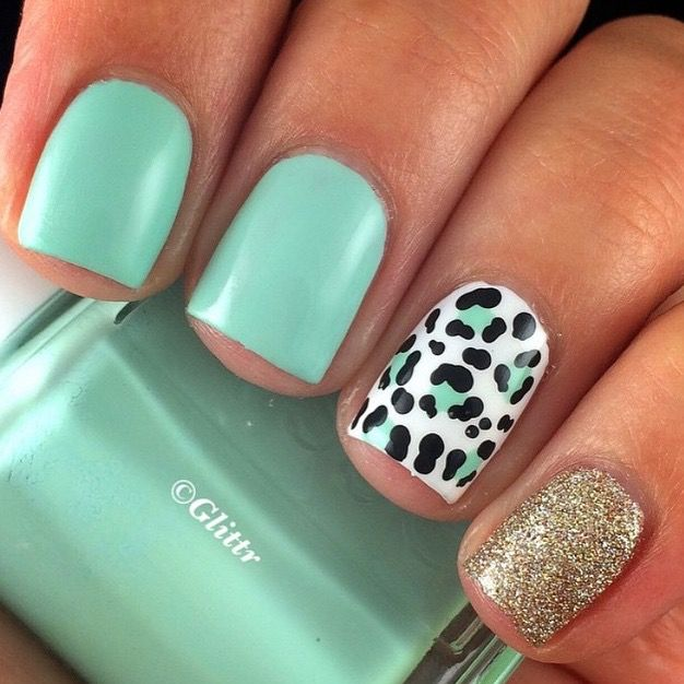Mint and gold nails, with a leopard accent.