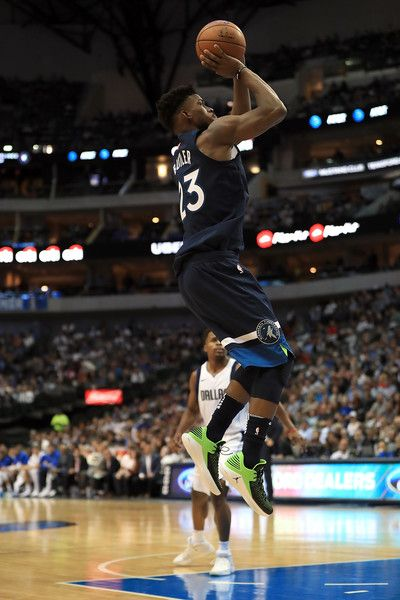 Jimmy Butler Photos - Jimmy Butler #23 of the Minnesota Timberwolves takes a shot against the Dallas Mavericks at American Airlines Center on November 17, 2017 in Dallas, Texas.  NOTE TO USER: User expressly acknowledges and agrees that, by downloading and or using this photograph, User is consenting to the terms and conditions of the Getty Images License Agreement. - Minnesota Timberwolves v Dallas Mavericks
