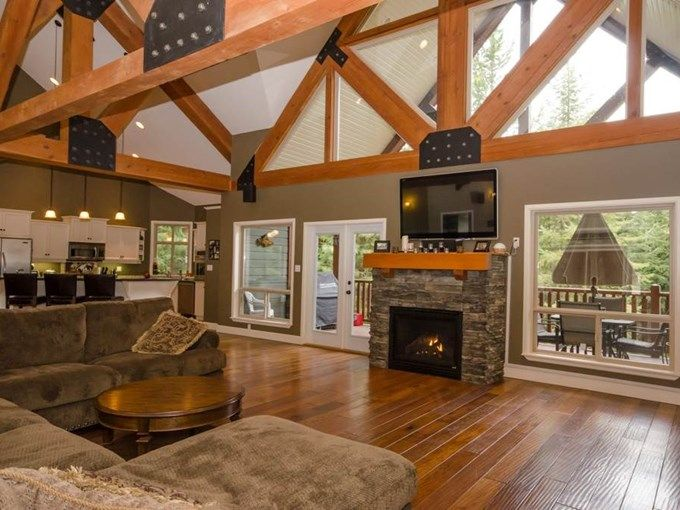 Home for Sale - 67 Shuswap River DR, Lumby, BC V0E 2G6 - MLS® ID 10079981  Rustic Mountain home.  Living Room. Fireplace