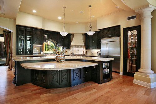 i love how open this kitchen is, especially with the large island in the middle