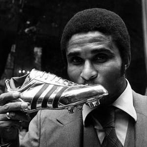 "Eusébio da Silva Ferreira, a.k.a. ""King"", ""Black Panther"". 1942-2014.  Best world player - golden ball 1965. Two-times silver ball award - 1962, 1966. Portugal national team - 3rd place England'66. Benfica team player - 11 championships, 1 European Champions Cup, 3 times finalist at European Champions Cup, 5 Portugal Cups. 733 goals on 745 matches. Two-times European golden boot- 1968.1973.  An humble genius, a true champion, top-3 player of the 20th century football."