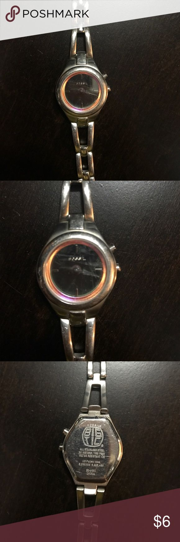 "Fossil Watch - ""Big Tic"" ⌚️ Watch This is a used Fossil ""Big Tic"" watch. Stainless steel, black dial with pink almost iridescent ring around the outside of the dial. There are a few scratches on the crystal which I tried to capture in the pic. Just needs a battery and you're ready to look stylish in your Fossil ⌚️ Fossil Accessories Watches"
