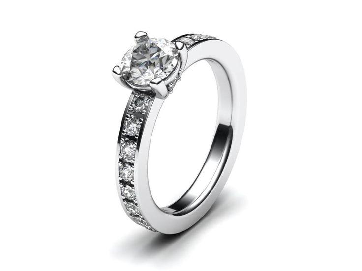 Nový, jemný zásnubní prsten klasického vzhledu s větším centrálním kamenem.