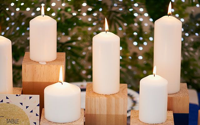 Create these beautiful candle blocks for your wedding to add instant ambiance.