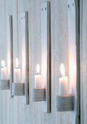 Candle holders on the wall