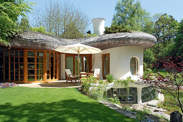 The organic design and living, landscaped rooftop of this whimsical residence blend into the surrounding hillside. Located in Gründwald, the property is about eight miles from the center of Munich.