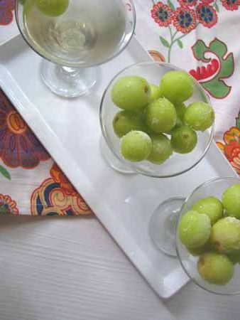 "marinated-grapes in white wine.  Whaaat? Why would you marinate GRAPES in WINE?  Because it's fantastic - that's why.  Grapes and the ""marinade"" are both enhanced by the flavor imparted from the other."