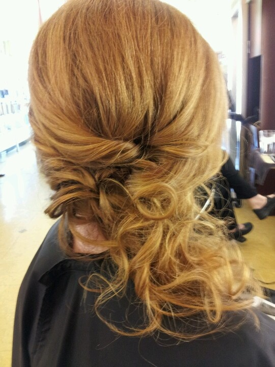 Wedding hair style down and to the side.