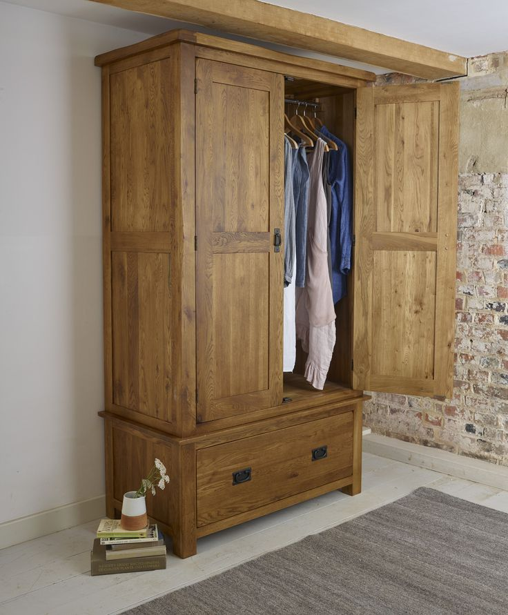 The Original Rustic Solid Oak Double Wardrobe is crafted by skilled joiners from only the highest grade oak. The wood is finished in a gently stained wax to create an antique effect and a rich, mature grain.