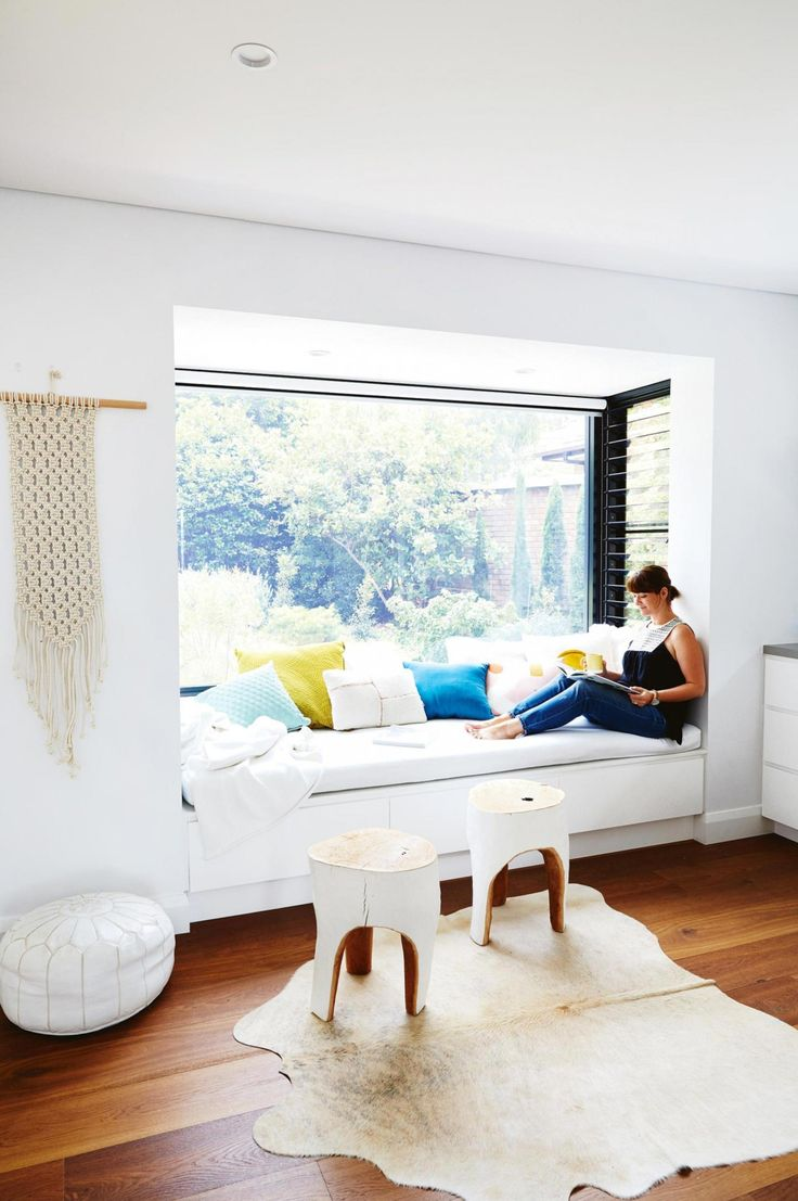 Home tour: Scandi minimalist style in a white and bright home with pops of color. Love this reading nook in he window seat! Photography by Cath Muscat. Styling by Vanessa Colyer Tay. From the February 2017 issue of Inside Out Magazine.