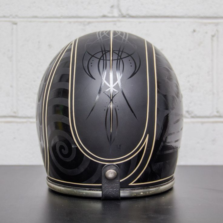 This beautiful vintage Arthur Fulmer full face helmet has been custom painted by Jeff Wolf of Wolf Designs.