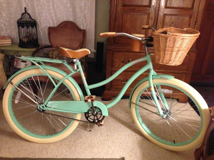 My Huffy mint green beach cruiser bike. I replaced the small silver basket it comes with with a wicker one.