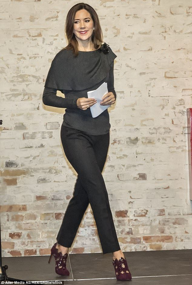 Although always stylish, her statement was more subtle, pairing a fine-knit Prada sweater with tapered black pants