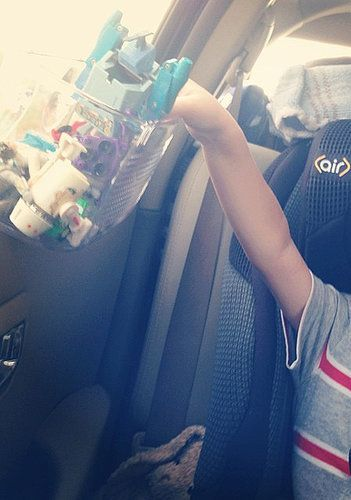 Keep kids' toys, snacks, and other supplies within arm's reach by attaching suction cups to a shower caddy and mounting it onto the window.  %0ASource: Instagram user alliaars