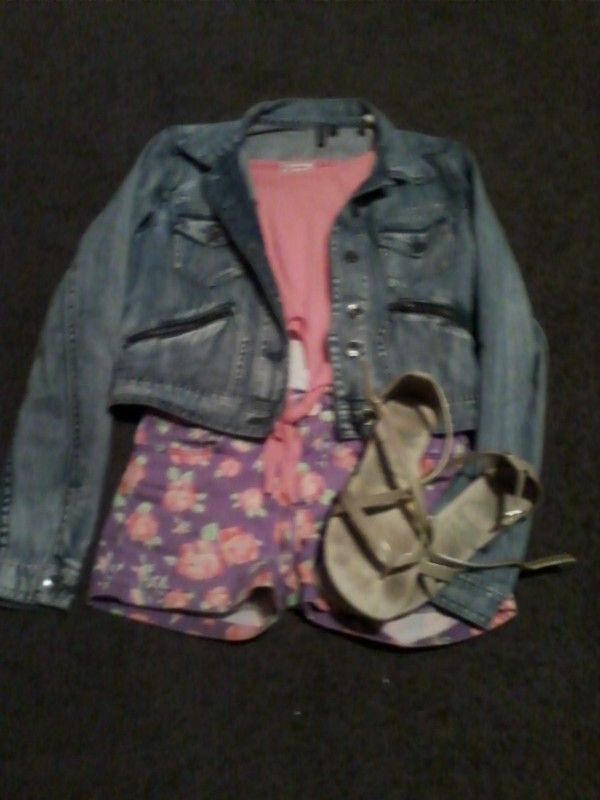 Cute denim jacket over a singlet and crop-top. Purple flowery shorts matching the crop top and sandals that are a goldie colour,could also wear this outfit with purple converses.