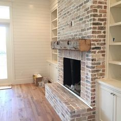 Rustic brick and wood beam fireplace is another good option