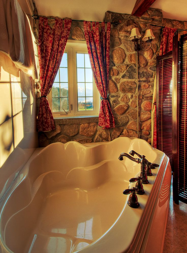 Gorgeous hot tub with a view of the vineyard.