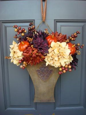 """Fall Door Hanging by marcia- I think this is the old """"Southern Living At Home"""" bucket they've put the flowers in."""