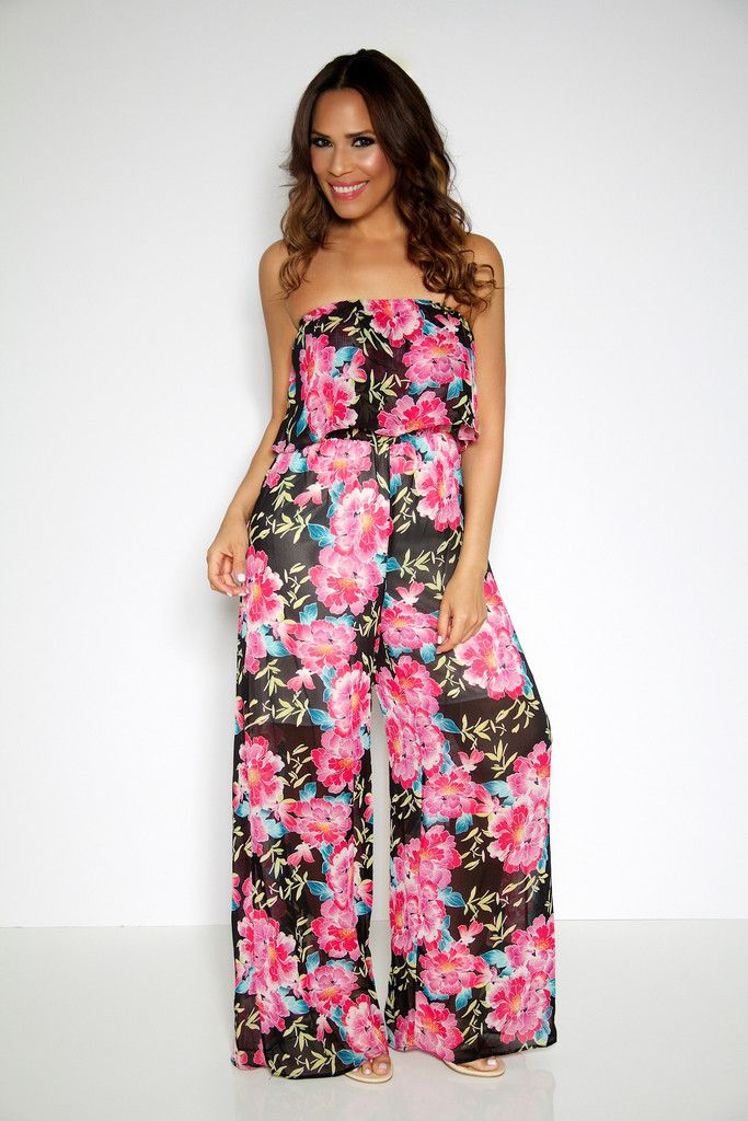Wow them all in this fabulous multi-colored floral jumpsuit. Celebrity inspired this jumpsuit will really stand out in a crowd, the ruffled off the shoulder neckline and chic floral print makes this jumpsuit a statement piece that is set to be the biggest trend this summer. Perfect for any big night or day out you have the summer essential that you really cant live without.
