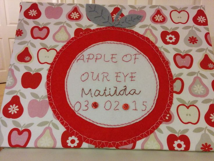 Commemorative wall plaque for newborn baby girl. Apple of our eye embroidered on felt apple applique with baby's details. Can include time of birth, weight, etc.