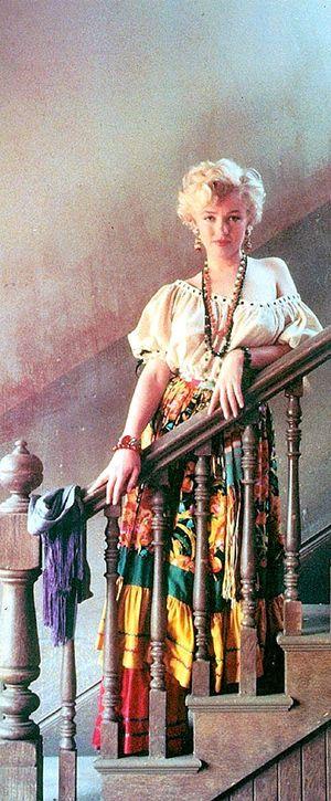 Marilyn. Gypsy sitting. Photo by Milton Greene, 1956.