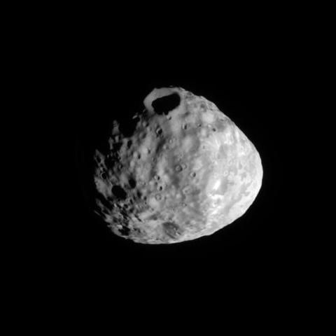 The Cassini spacecraft eyes a prominent crater on the moon Janus.    The south pole lies on the terminator at the bottom left of the image. This view is centered on terrain at 16 degrees south latitude, 64 degrees west longitude. This view looks toward the leading hemisphere of Janus (179 kilometers, or 111 miles across). North on Janus is up and rotated 31 degrees to the right.