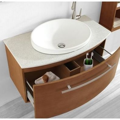 curved bath vanity with side-mounted faucet and towel bar is handle
