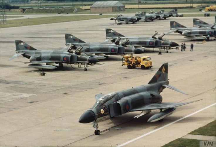 RAF Phantoms at RAF Coningsby, July 1974. A Phantom FGR2 of No 111 Squadron RAF taxies past past other Phantoms of the Coningsby Wing