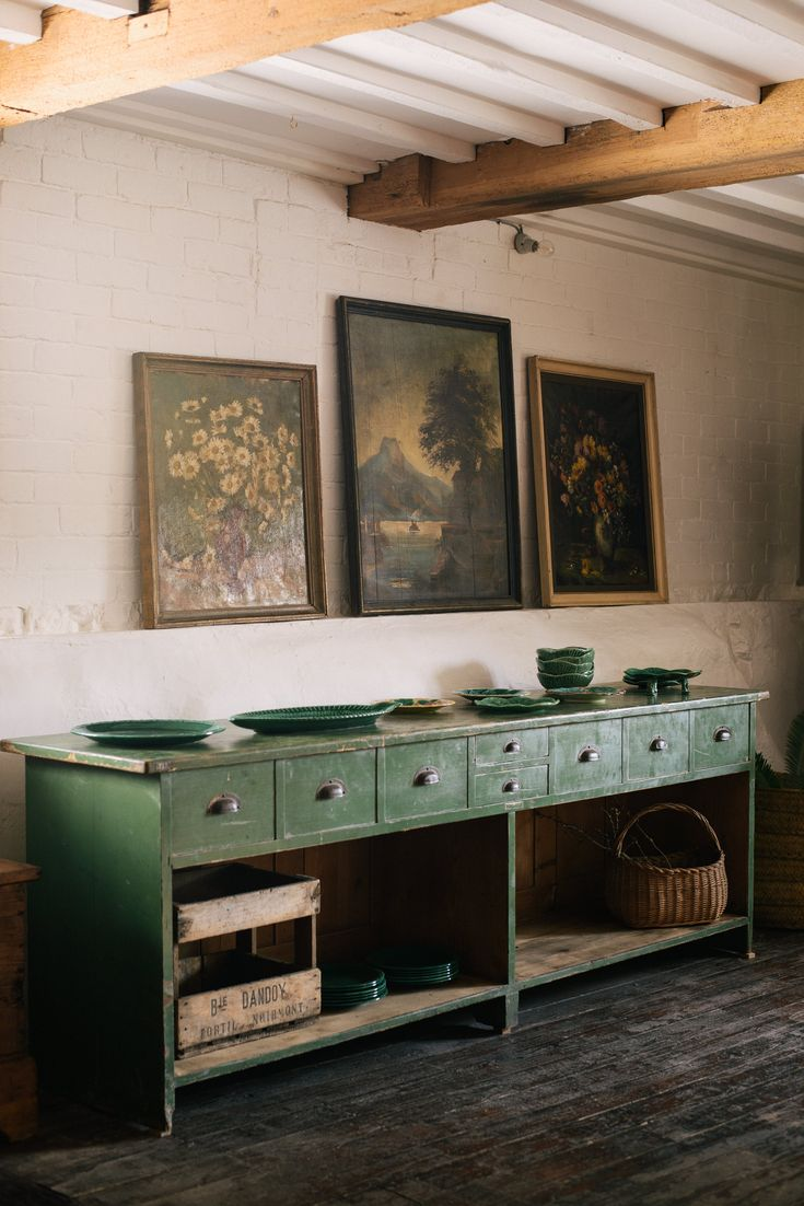 An antique serving table provides the perfect statement piece for any room