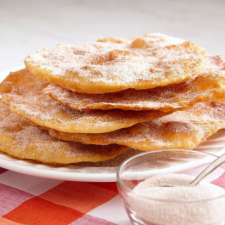 Most Latin American countries have some variation of buñuelos, the deep-fried fritter that is popular around Christmas and New Year's Day. This Mexican version is coated in cinnamon sugar and if desired, drizzled with an anise-spiced syrup.