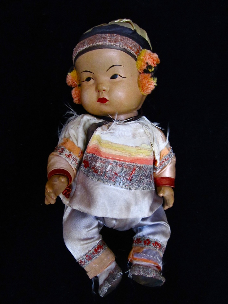 "ca. 1930 Ming Ming Boy Doll made by the Quang Quang Co. of Los Angeles.    This doll stands 10"" high, is made completely of composition and has a long black braid down his back. He is dressed in his original Chinese style silk outfit, including hat and shoes."