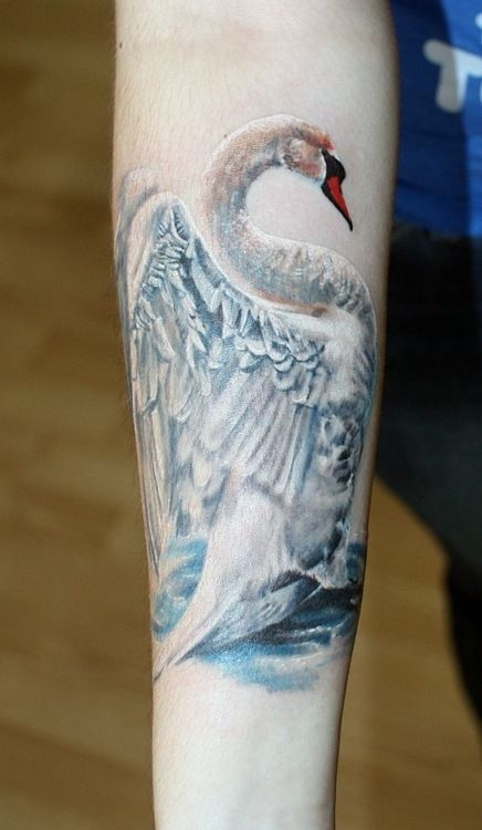 Vanya Yug swan tattoo looks 3D like you could feel the texture of the wings