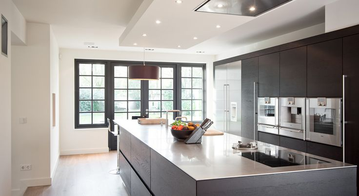 contemporary kitchen in matte black with floor to ceiling storage and built-in appliances  - detweedekamer.com