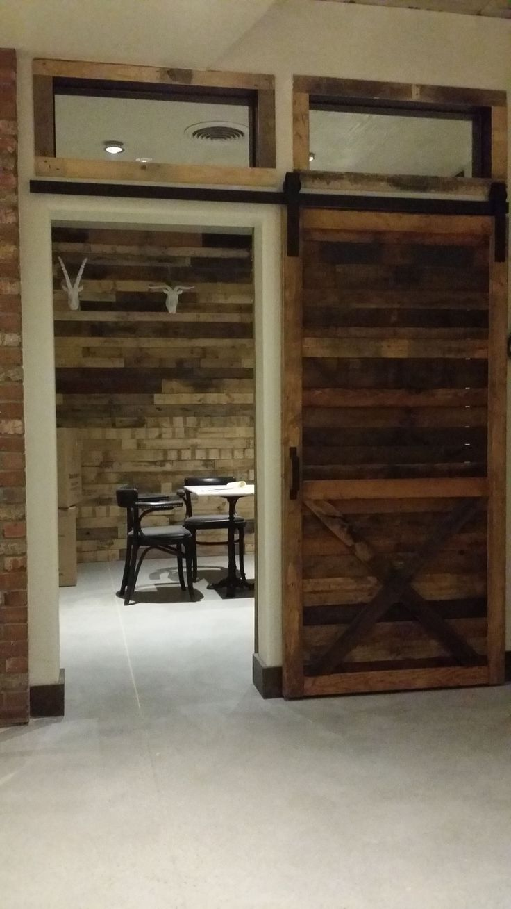 Farmhouse Style Barn Door Using Rustic Reclaimed Wood And X Bracing.  Located In San Diego