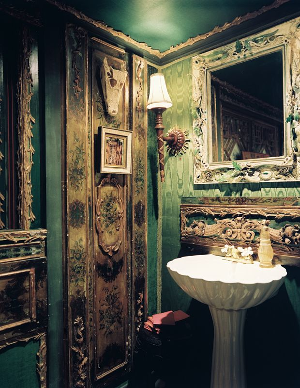 Powder room wrapped in emerald silk moire