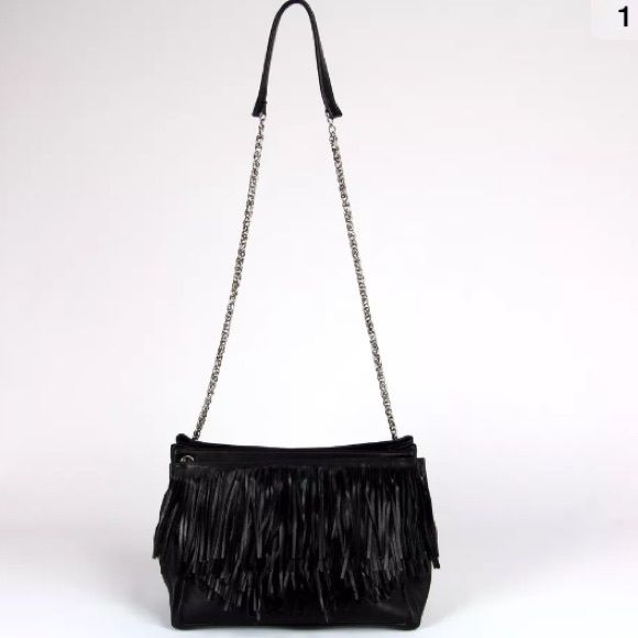 ON SALE! Christian Louboutin Artemis  Handbag ON SALE! FOR 1,300$ ON MERCARII! Louboutin Artemis Fringe GORGEOUS! MEDIUM size,soft supple leather & a cascade of fringe, adorns the shoulder strap of this classic Louboutin bag.What makes the bag unique, is that the chain strap is adjustable, allowing you to wear fringe, either on the shoulder, OR the front of bag!! Very versatile, done in classic Louboutin style a truly stunning statement piece.❤️ SELLING 4 LESS ON MERCARII CONSIDER TRADE…