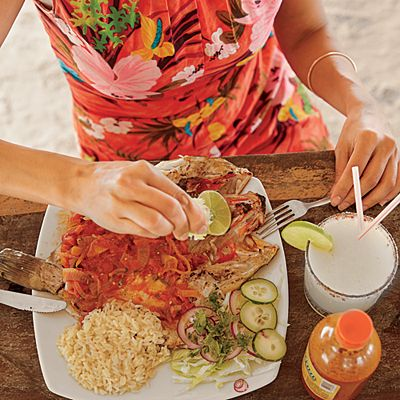 At Raices in Isla Holbox, Mexico, a whole-fish platter of red snapper needs only a squeeze of fresh lime.