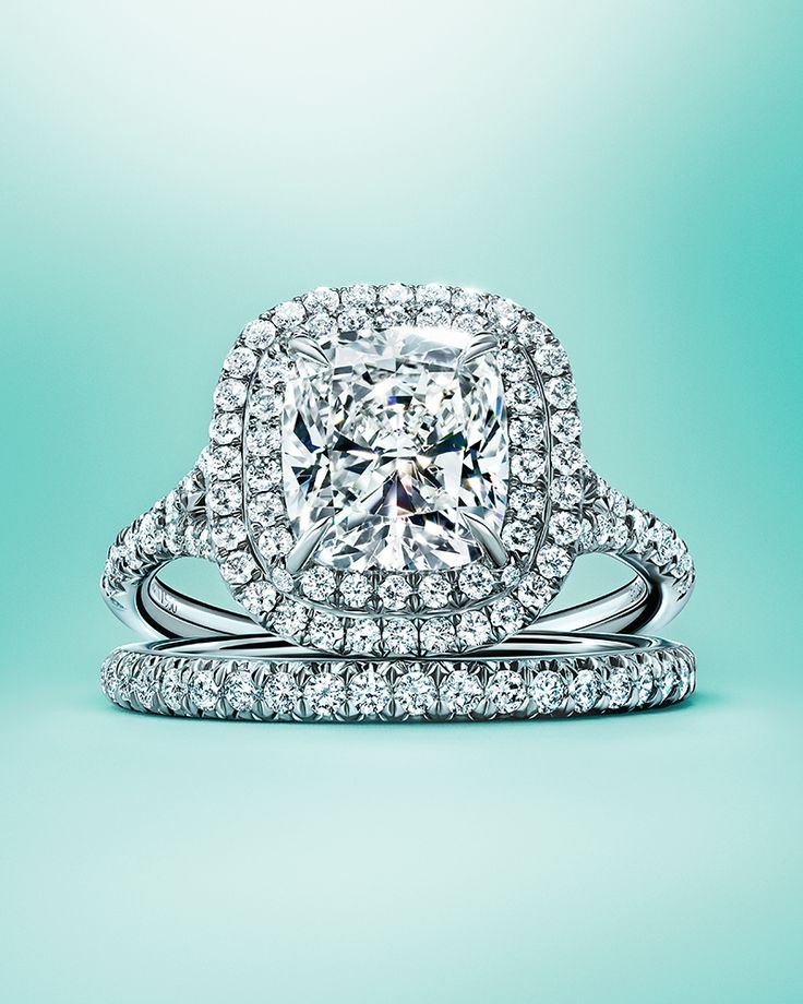 Tiffany Soleste engagement ring and Tiffany Metro band ring in platinum.