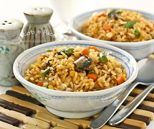 Please share Culinary history was changed forever when someone long ago in China introduced rice to wok! The humble steamed rice, tossed with seasoning (normally soy sauce) and oil, seared with the intense heat...